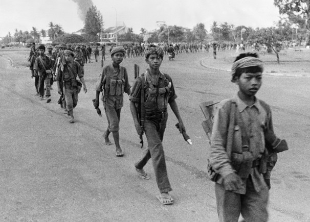 Khmer Rouge child soldiers enter Phnom Penh.