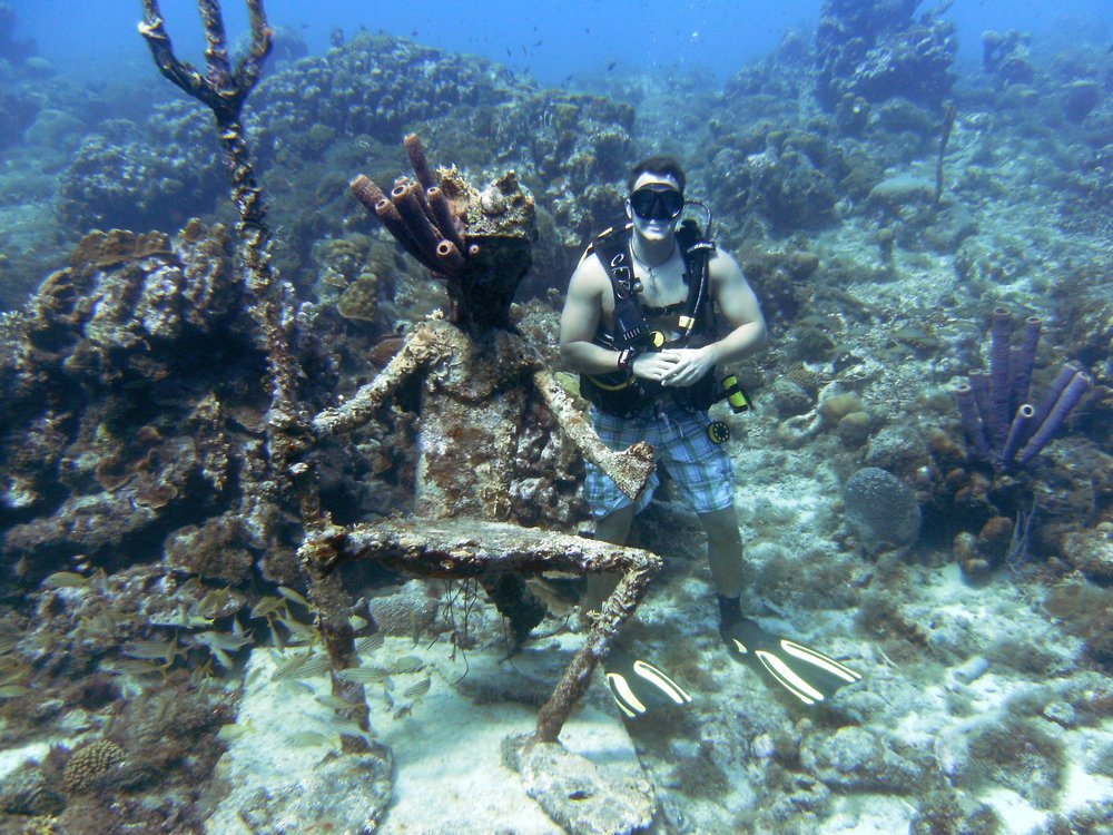 Adam Pulice    SSI Dive Control Specialist      Adam started diving in West Virginia, in 2009, with Tige and Monica. He enjoys his role as a Dive Con, but has plans to advance to Open Water Instructor.  He enjoys introducing new divers to the dive life. Adam's favorite parts of diving are the adventures in and out of the water and getting to meet new people.