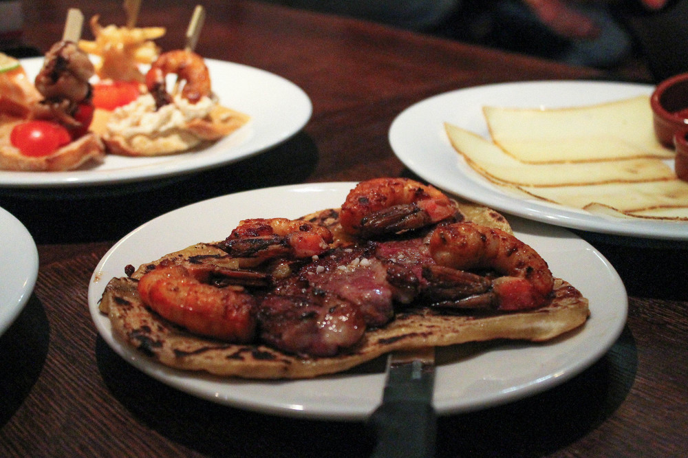 Basque tallo with grilled prawns and skirt steak,  sheep cheese with black cherry confiture, various pintxos