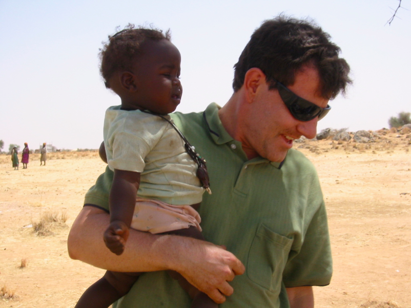 Kristof and baby, IDP Camp, Chad  Photo Winter Miller