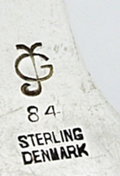Example of one of the earlier GJ hallmarks. Although this marking might indicate a 1904-1908 date, the fact that it is marked sterling dates it later. This is still a Jensen piece however, as this marking was also used later for other, smaller pieces till 1945.