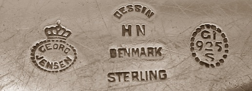 "Here's an example of yet another unusal hallmark. You can clearly see the ""Georg Jensen"" hallmark with the crown which was used between 1925 and 1932. Also present is the GI .925 mark and the designers initials (In this case, Harald Nielsen). This mark was also used on some of the smaller pieces in later years and bears a striking resemblance to the more current hallmarks used. Because of this, knowing the time period of the design and its production period is essential to dating the pieces."