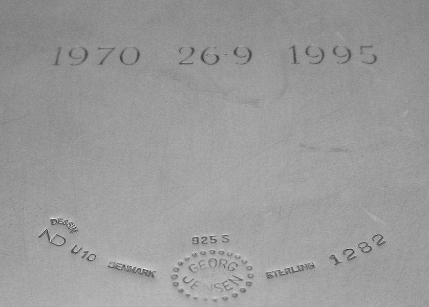 The U10 mark present on this Nanna Ditzel piece is actually a year mark. After Georg Jensen had purchased the A Michelson silversmithy, they began introducing the Swedish dating system to some pieces. the U10 follows with the chart HERE to show that this particular piece was made in 1994. (the engraved dates were added later at the bequest of the former owner)