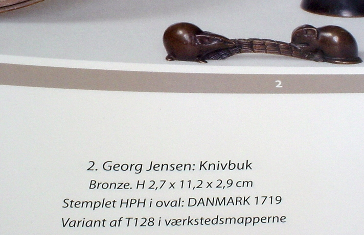 A knife rest, in bronze, designed by Georg Jensen for the Mogens Ballin workshop