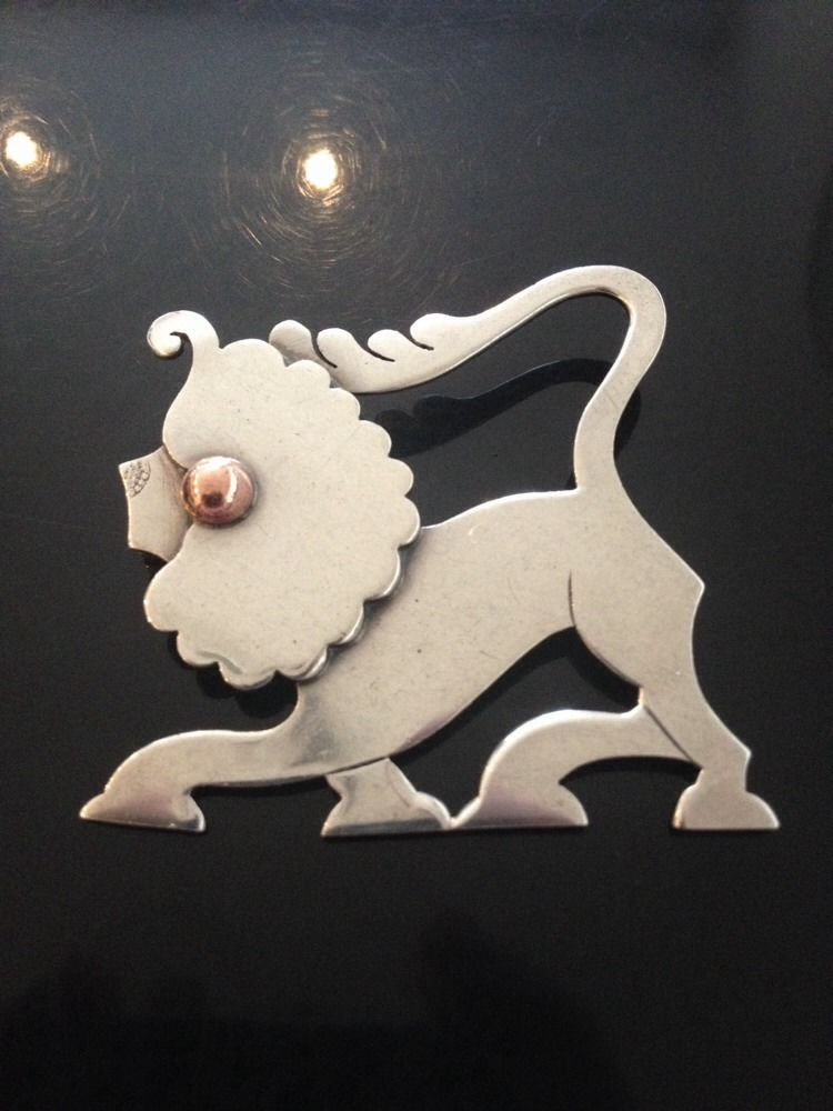 This unusual brooch actually uses the Georg Jensen hallmark to form part of the decoration of the nose of the lion. We're unsure if this is intentional or another example of a mistake in the stamping process, but it is, nevertheless, very unusual.