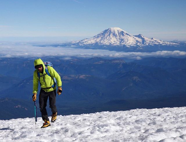 [ Mt. Adams, 10 of 10 ] @bowenjr at the summit of Mt. Adams (12,280 ft), with Mt. Rainier looming in the distance. The climb took us nearly seven hours to complete, and were able to glissade down the same route in only two. We made it down the mountain before lunch and celebrated the adventure with beers in small-town Trout Lake. #mtadams #washington #cascades #mountaineering