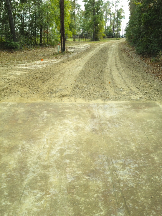The edge of GS-5 treated road, battered by heavy vehicles and grading equipment.