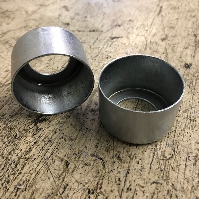 Valve spring cover cup