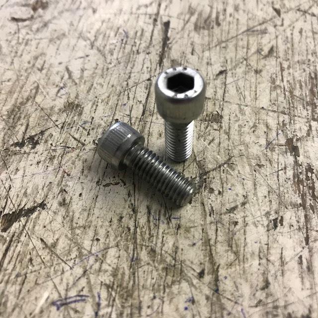 Valve spring cover bolt