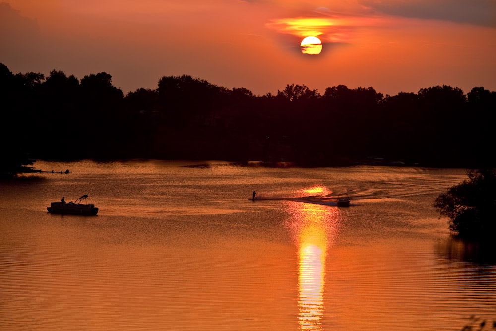 Last night, September 10 was on of the amazing Sunset on Upper Long Lake.  In the waning evenings of summer, there was our ubiquitous water skier crossing the reflection of the sun when his mother boat was still on right side. There was a lone fishing person in a pontoon watching it.