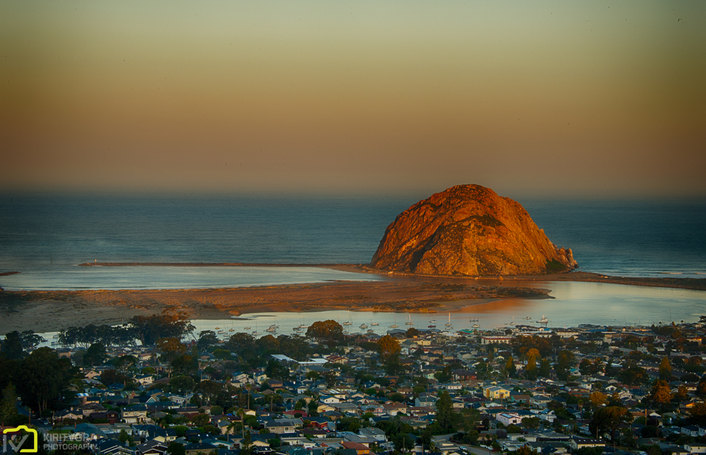 Here was the Morro rock drenched in golden glow of the sunrise we were watching.