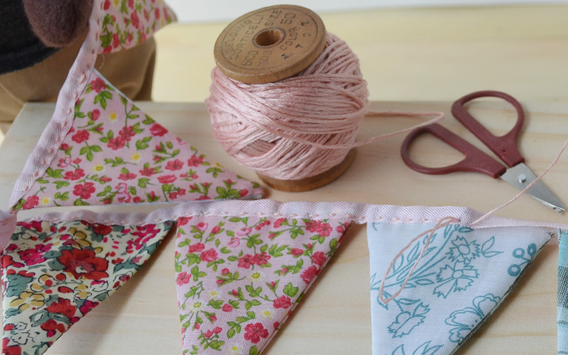 If you want to do this project at home, you can download a PDF patternhere.It has patterns for animal and human-sized buntings. You can sew it by hand or with a sewing machine. And you can share photos of your work onour facebook page!