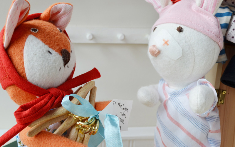 In the morning when the varnish was dry, Flora brought the hangers to the rabbit twins.