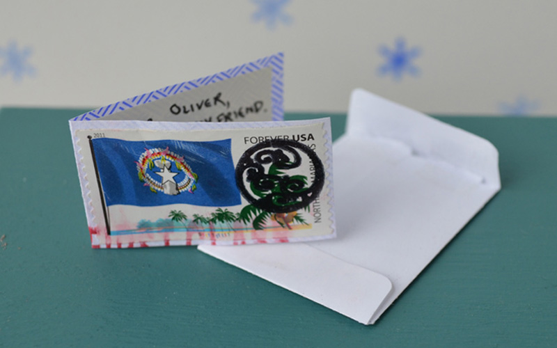 After Oliver had visited all the houses on his route there were still a few valentines left in the bag. These were for him! He hurried back home to open them. Here's some of what he found: Max made a card out of a postage stamp from his collection.