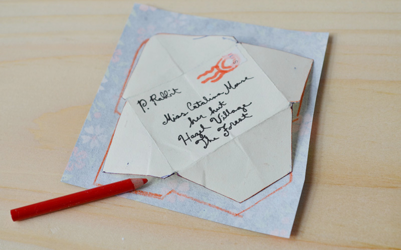 They decided to make their valentines really special with custom envelopes. So they very carefully took apart a regular envelope Catalina already had and traced the shape onto different kinds of pretty paper.