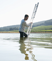 man in ladder in water.jpg