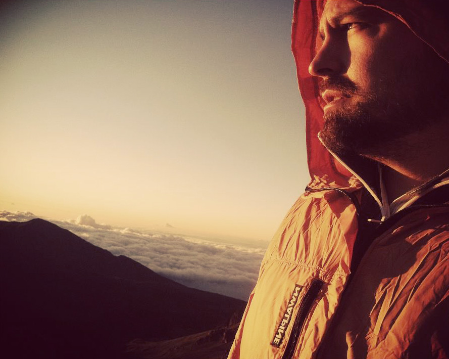 Garrick Bushek enjoys the early morning glow.   Haleakala, Maui