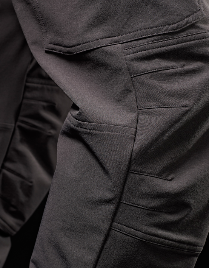 We use high quality four-way stretch woven, breathable fabric with DWR (durable water repellent) coating and an abrasion resistant face.