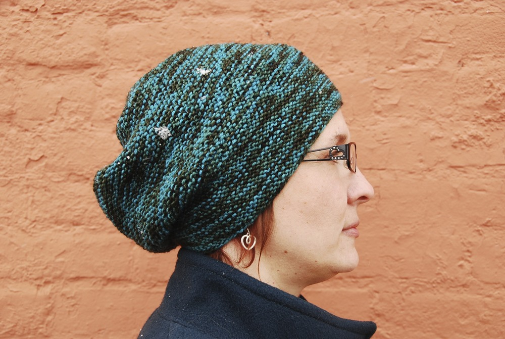 Joy wearing Rikke.  design by Sarah Young, knitting by Stashmuffin