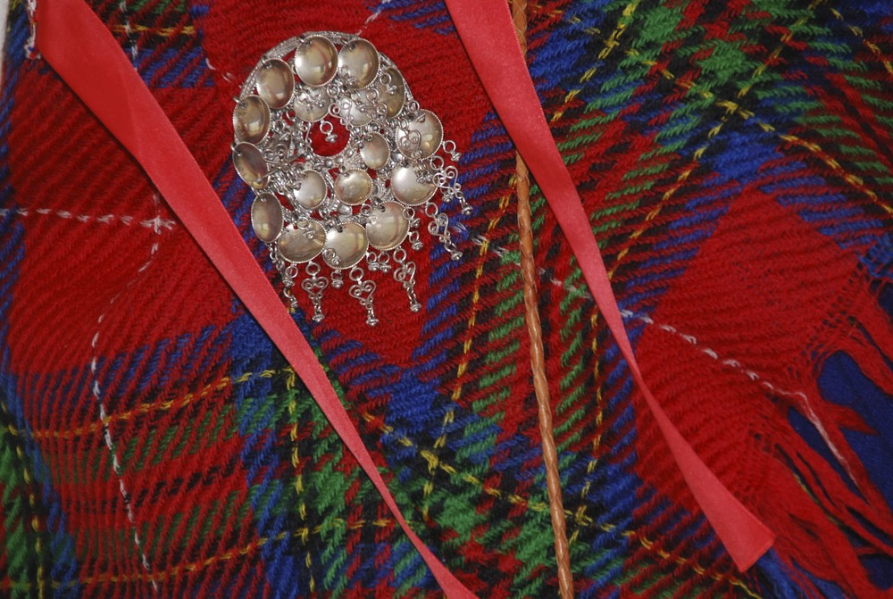 The woman's gákti shawl and brooch.  From Enontëkio, Finland.