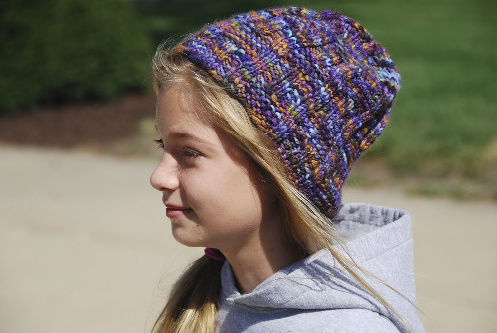 Rachel in the Woman's Wavy Gravy hat in Malabrigo Twist.