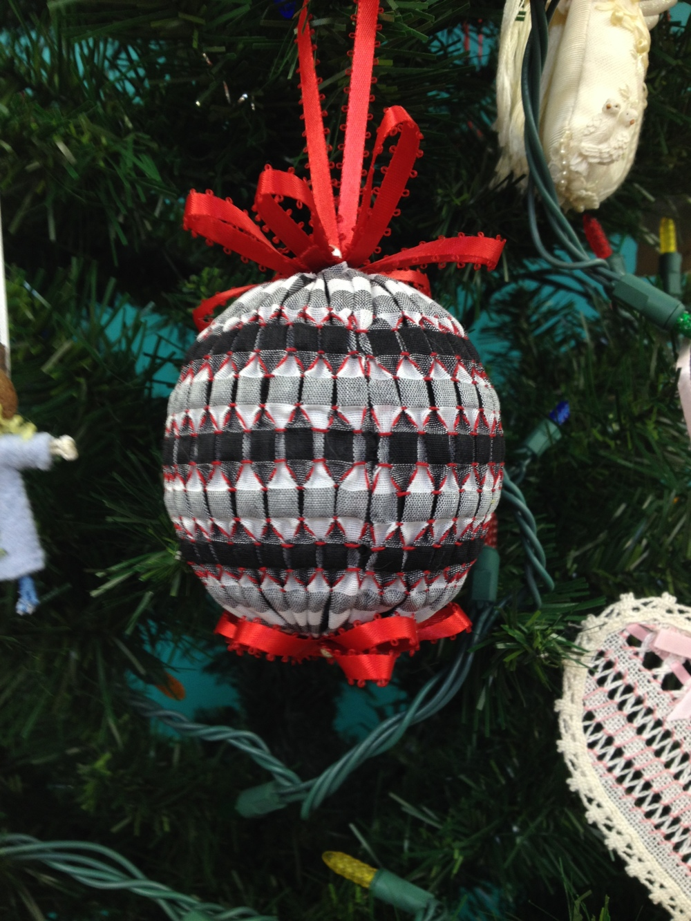 smocked ball on gingham fabric