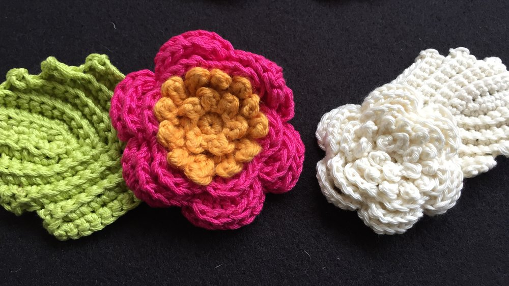 Irish crochet rose, leaf and stamen seen in colored, worsted weight yarn, and cream, dk weight yarn