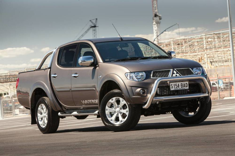 Customer's under-warranty Mitsubishi Triton does the 'James Bond smokescreen' bit; dealer doesn't help - typical...