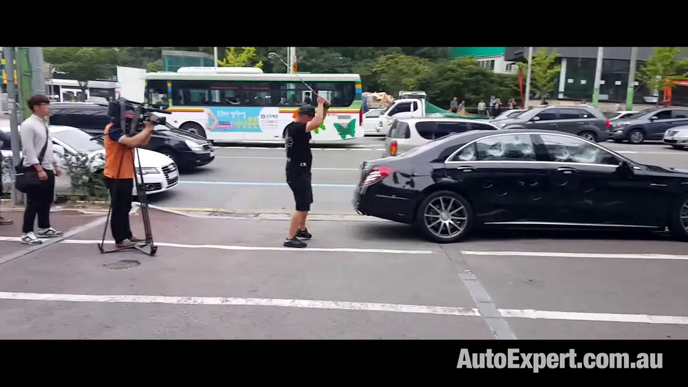 Je-Ha Yu - took to his Merc S-Class with a five-iron, outside the dealership...