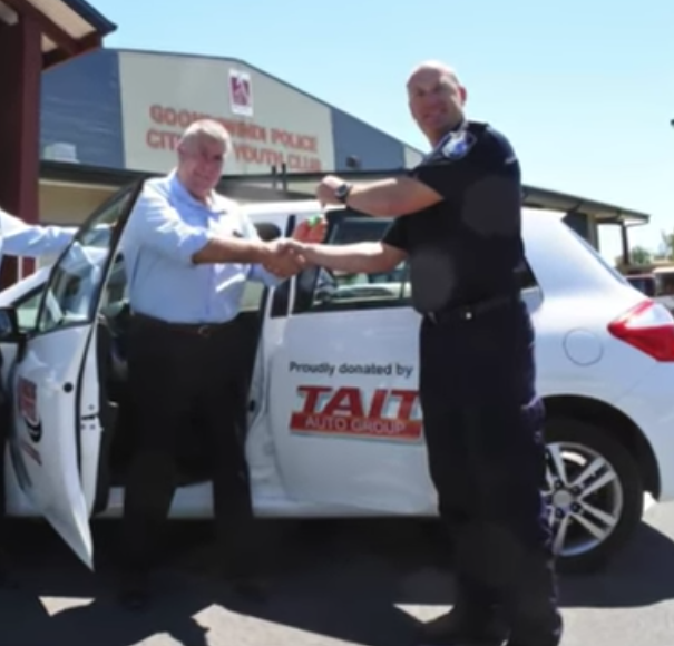 David Tait, left, donating a free car to the local cops - another potentially bad look in the domain of potential conflicts of interest