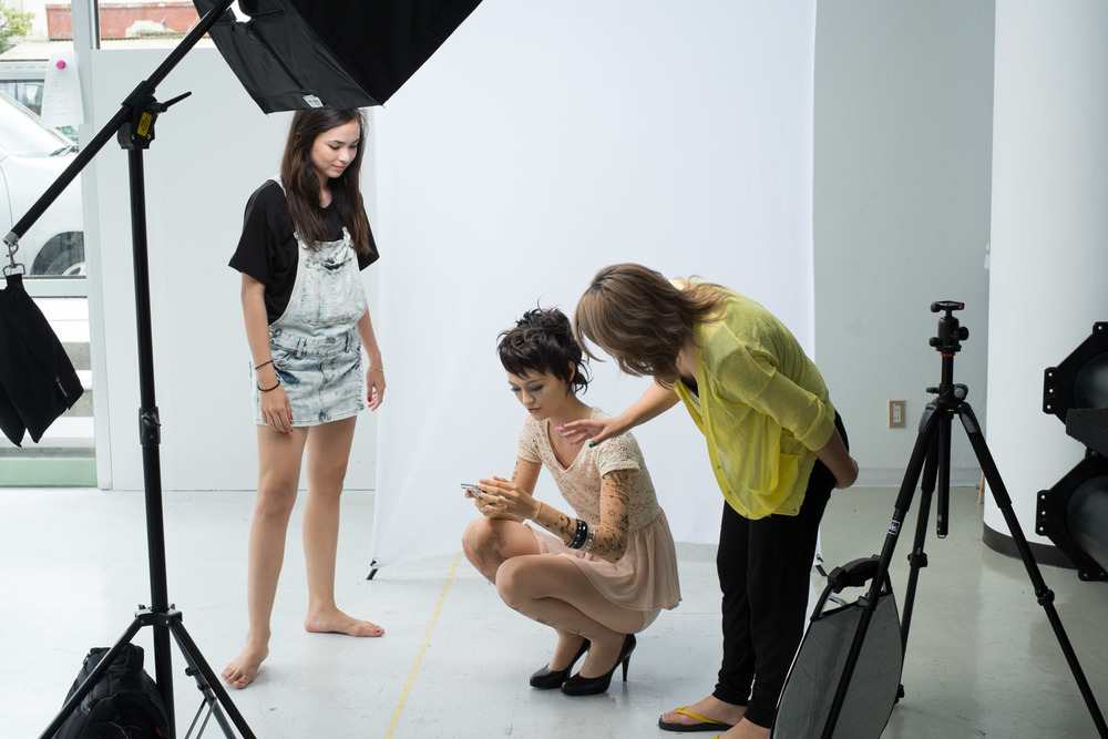 Behind-the-Scene shot of Yumi discussing the shot with Lorena while Marie looks on.