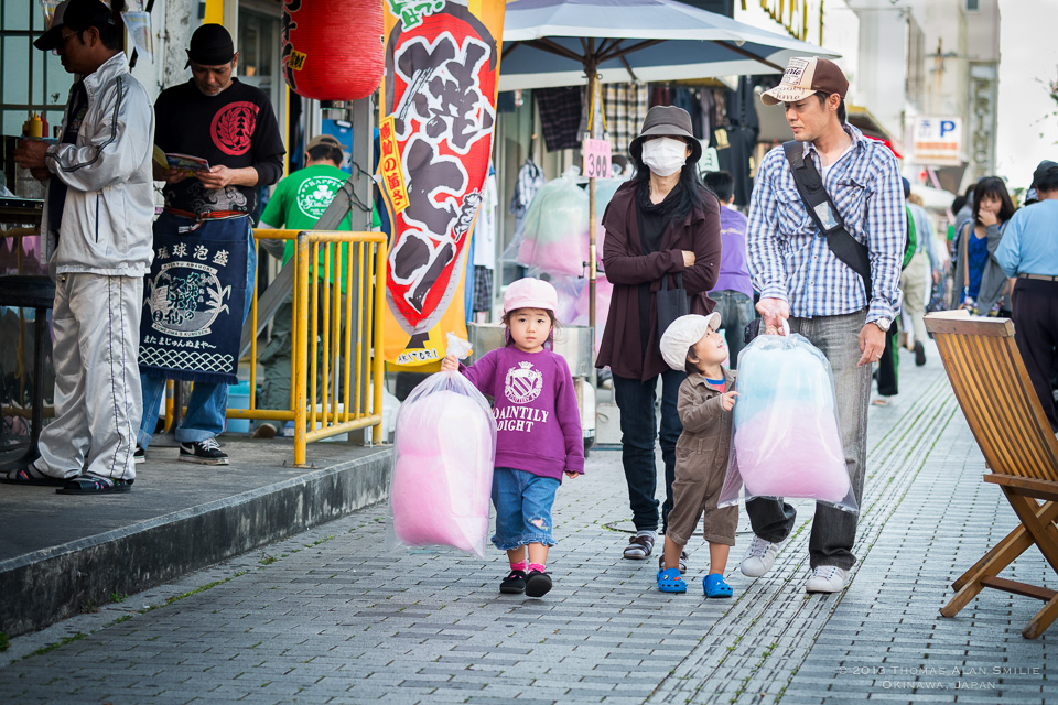 A family walking together at a local festival in Okinawa, Japan. Fuji X-Pro1
