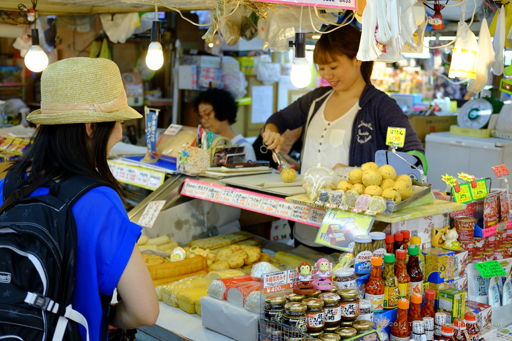 Naha Market. Fuji x100s with TCL-X100 Teleconverter Lens.  SOOC with Fuji Velvia camera profile and Lens Correction applied. f/2.8, 1/100 sec, ISO 500.