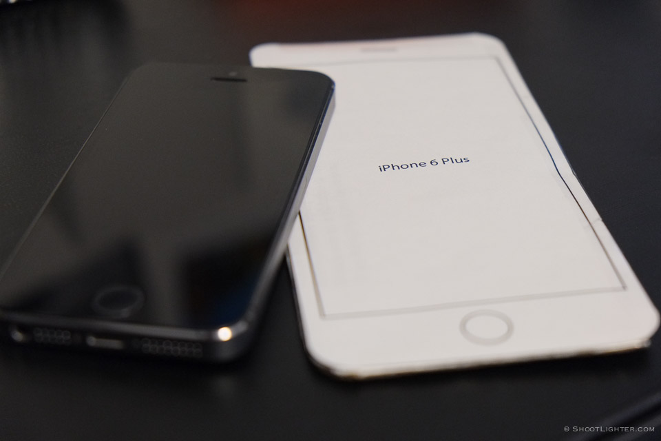 My iPhone 5s next to an iPhone 6 Plus mockup, the closest thing I can get right now to the real thing. :)
