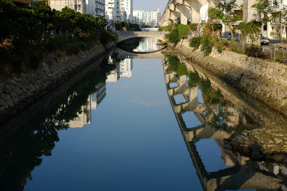 Reflections in the river. Naha, Okinawa, Japan. Fuji x100s w/ TCLx100 Teleconverter at ISO 200, f8, 1/220 sec.