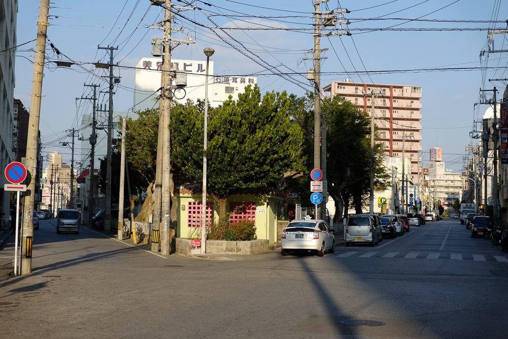 Streets of Naha, Okinawa, Japan. Fuji x100s w/ TCLx100 Teleconverter at ISO 200, f4, 1/1000 sec.