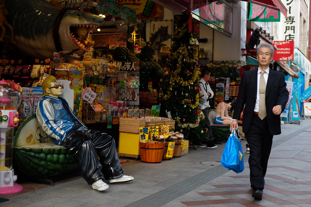 A businessman walking on Kokusai street in Naha, Okinawa.