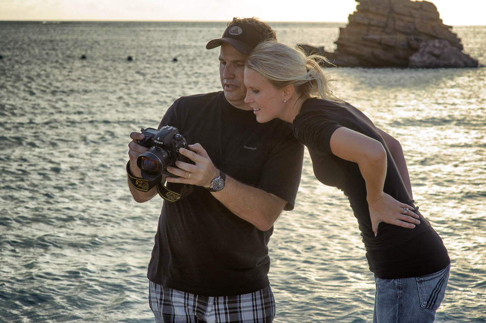 Before I started shooting with Fuji X-Series cameras. This is a behind the scenes shot from 2010 reviewing images with graphic artist Rachel V. at a U21 magazine shoot in Okinawa.