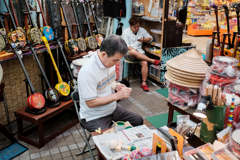 An Okinawan Sanshin 三線 shop keeper in Naha, Okinawa Japan. Fujifilm x100T, ISO 400, f/2.0, 1/110 sec,  Fujifilm c  hrome film emulation , edited in Adobe Lightroom 6.