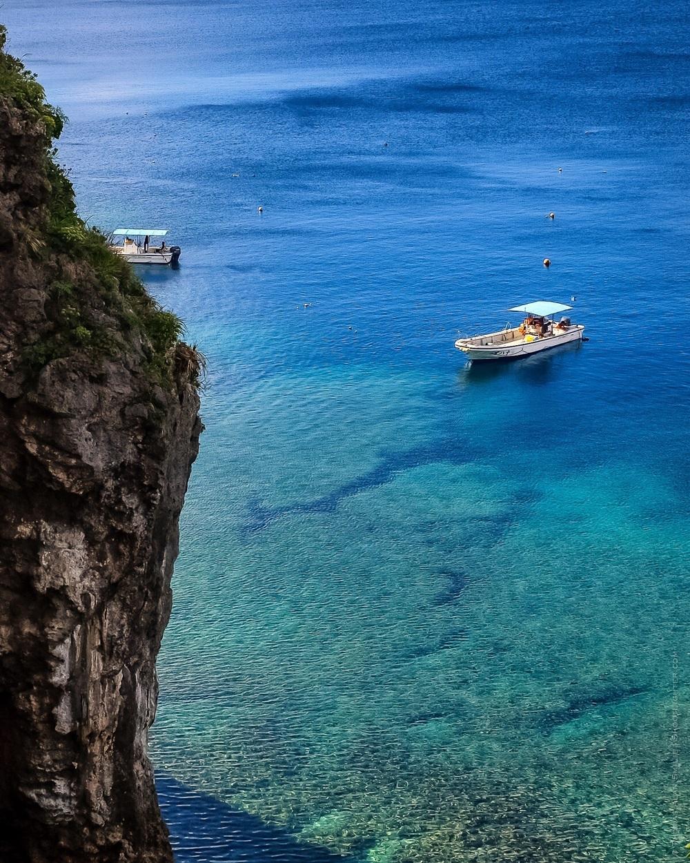 Diving boats at Cape Maeda in Okinawa, Japan. Fuji x100T