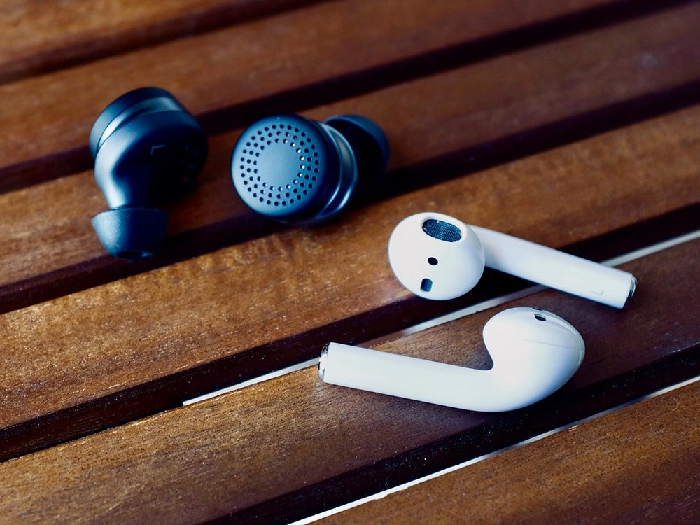 Here One Earbuds and Apple AirPods side by side.