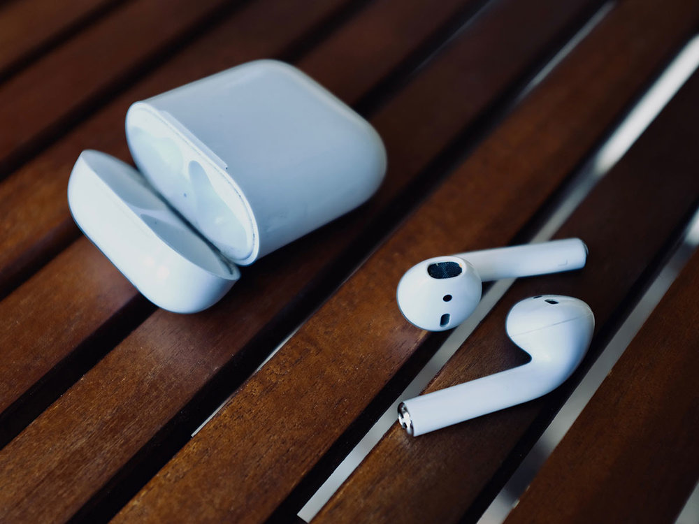 Apple AirPods 1 and charging case.