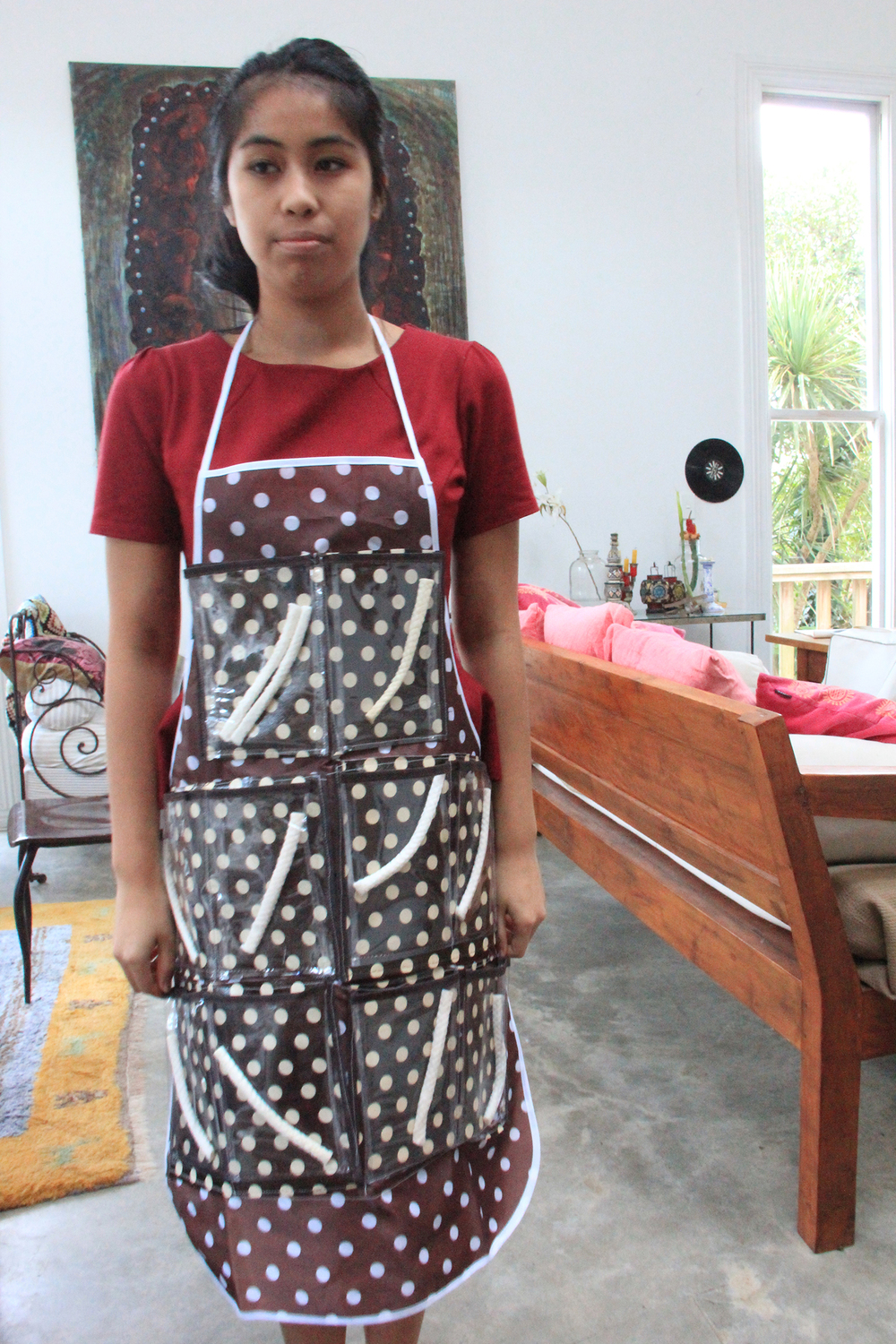 Jane Nimsoongnem models the perfume stick apron