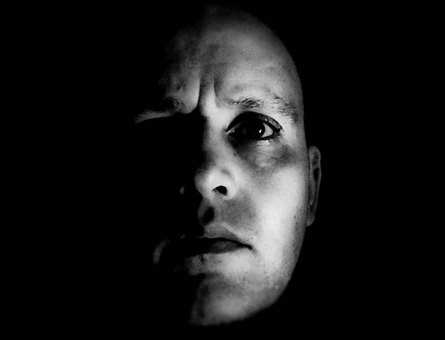 Playing with a black and white self portrait...still got a bit to do with the lighting.
