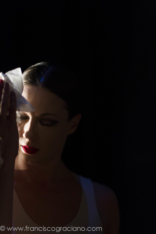 Laura Halzack blotting sweat off her brow during Paul Taylor's  Le Sacre du Printemps . Portland, OR.