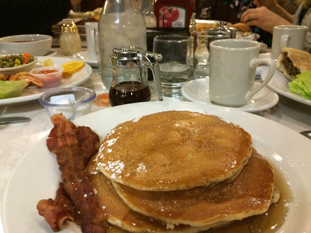 My pancakes, and a view down the very full table.
