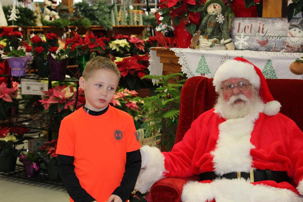 Brayden cautiously giving his list to Santa!