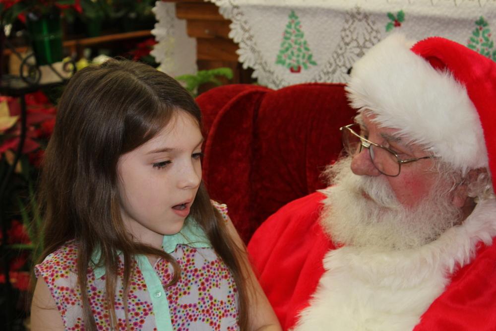 Jaelyn telling Santa her secret wish!