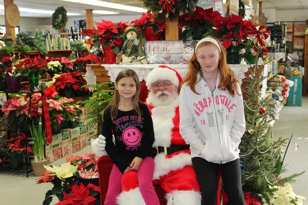 Miranda & MacKenzie warm up to Santa!