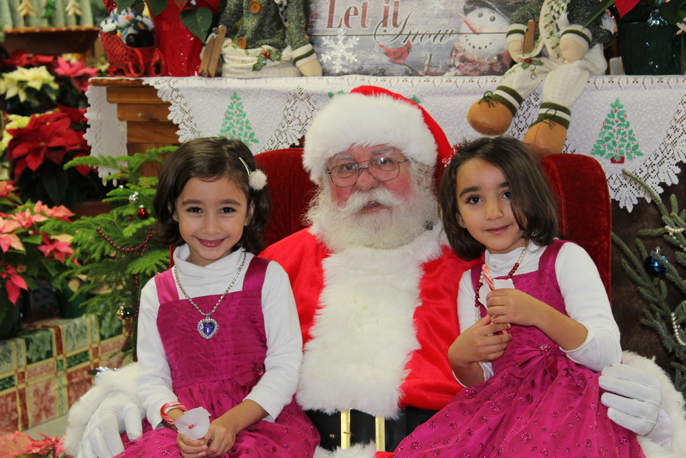 Sereen and Sarah enjoy their time with Santa!